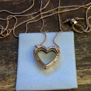 Rose gold winged heart locket bolo necklace
